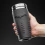 Batman Rubber Travel Mug. THe textured rubberised finish is designed for maximum grip.