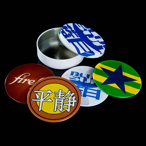 Firefly Coaster Set. Made from metal wrapped over a non-slip cork backing, each coaster measures 3.5 Inches and includes the following iconic emblems - Blue Sun logo - Serenity nose art - Star of the Independents - Firefly logo.