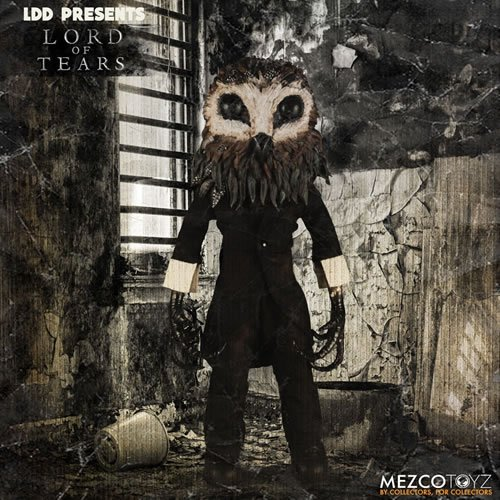 Living Dead Dolls Lord Of Tears Owlman Doll. From the award-winning film Lord of Tears. The Owlman features an all-new head sculpt depicting the unnerving creature. Dressed in a three-piece suit with his claws bursting from his sleeves, The Owlman is a ni