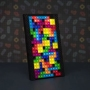 Tetris Tetromino Light. This light makes a fantastic gift. The light is USB powered and features a black board and 53 Tetriminos that you can place in as if you were playing Tetris.